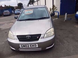 TOYOTA COROLLA WITH LEATHER SEATS AND LONG MOT IN GOOD CONDITION FOR SALE