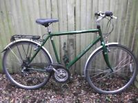 Raleigh large gents road bike 18 speed twist gears mud guards rack very good condition can deliver