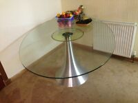 Glass top dining table with stainless base