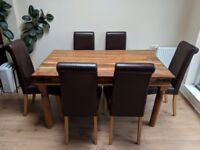 Real wood table and 6 leather chairs