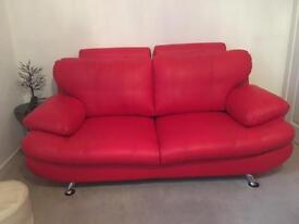 Brand new . Red leather sofas .
