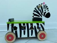 Ride on Zebra with wooden shapes game