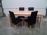 Ex display Very good Bargain price. Dining table and 4 black faux chairs. Can deliver.