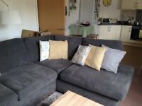 18month old DFS corner charcoal colour sofa with Dunelm scatter cushions. Very good condition