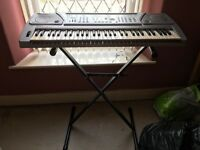 Piano/Organ with a stand