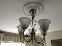 Brass effect pendant light with 5 opaque glass shades