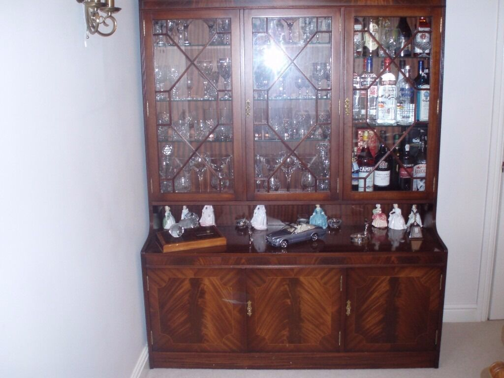 """Drinks and Display unitin Crewe, CheshireGumtree - Mahogany Drinks and display unit with three cupboards below,illuminated in display unit size 55"""" wide 69"""" tall and depth 9"""" top and 18""""lower Reduced for quick sale any reasonable offer considered.need space Good condition"""