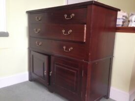 Solid antique mahogany drawers over two cupboards