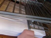 Matching pair of metal single beds with unused mattresses