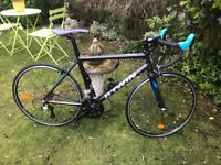GENTS/LADIES BTWIN TRIBEN 500 (VERY LIGHT CARBON FORKS) ROAD BIKE (LOVELY CONDITION)