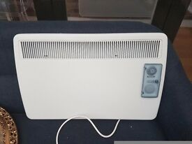 2 nearly new electric wall heaters