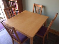 Beech extending dining table and four chairs