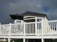 Haven Devon Cliffs, Sandy Bay, Exmouth, Devon 2 Bedroom Central Heated Caravan with Veranda for Hire