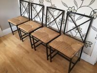 FOUR TRENDY METAL FRAMED CHAIRS WITH WICKER STYLE BASES