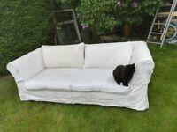 3 seater white sofa on wheels