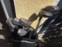 full set dunlop golf clubs and bag and trolley also 6 new balls and 4 others £15 07704652296