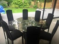 8 seater round smoked glass dining table