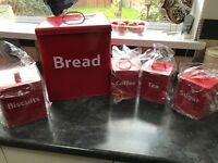 Red bread, tea coffee sugar and biscuit barrels New