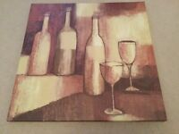A lovely wall hanging canvas style picture ....wine bottles & glasses