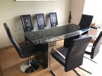 Designer glass extendable dining table