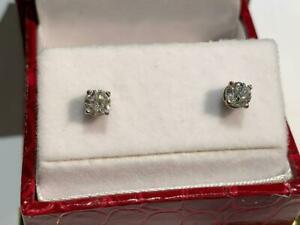 #194 14K WHITE GOLD CANADIAN DIAMOND EARRINGS WITH MAPLE LEAF SCREWBACKS - APPRAISED FOR $1750 SELLING FOR $595!