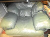 TWO GREEN LEATHER ARMCHAIRS IN EXCELLENT CONDITION
