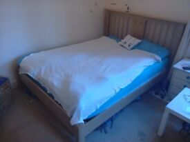 Wooden double bed woth mattress