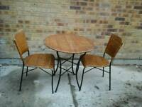 Ratten round table and 2 chairs.