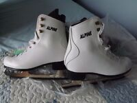 2 Pairs of ice skates (will sell seperately) like new. One black and one white pair