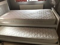 Single white wooden bed with guest bed includes 2 mattresses