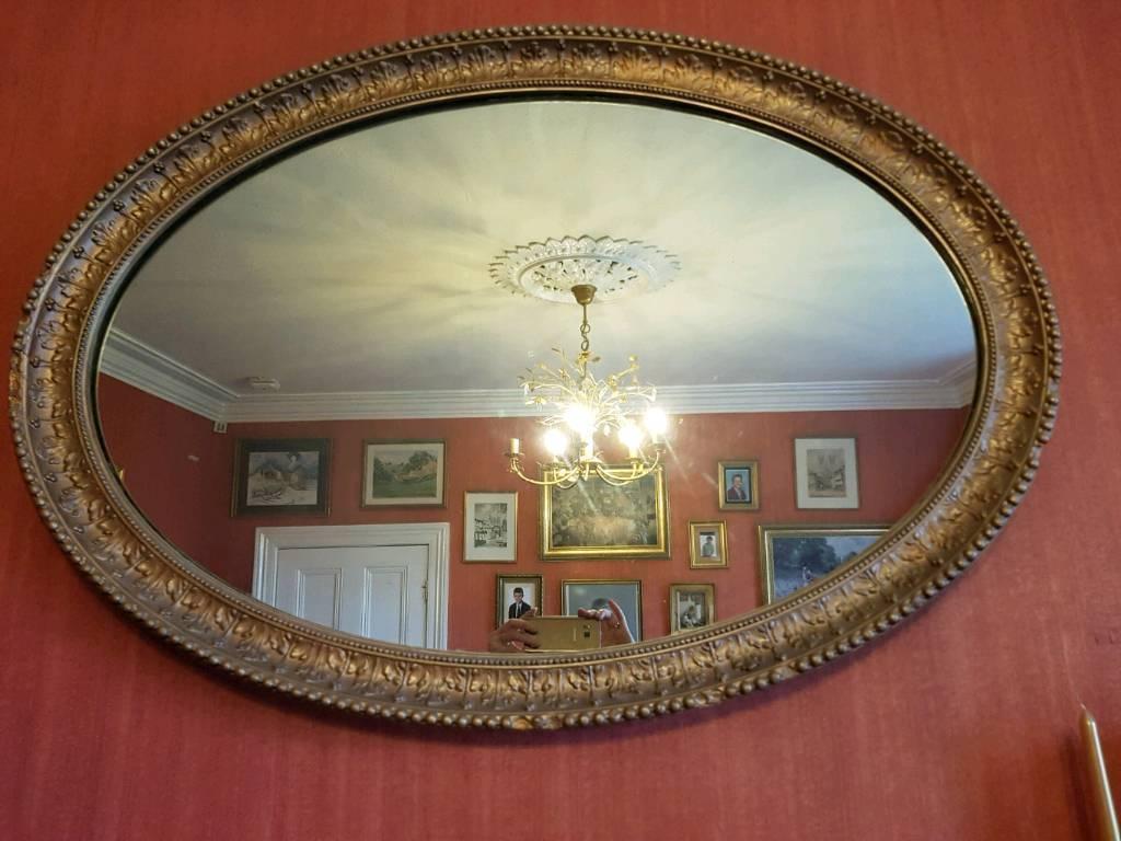 Vintage heavy oval mirror