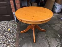 round wooden 4 seater dining table