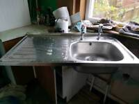 Silver kitchen sink and taps