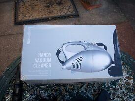 Small handy vacuum cleaner