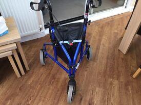 Three wheeled walking aid . Good condition hardly used.