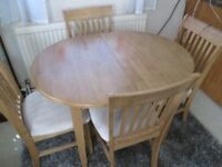 table and 4 chairs light oak very good condition