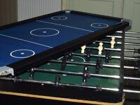 Foosball and air hockey table