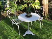 Vintage wrought-iron garden table and chairs