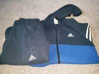 Two addidas tracksuits age 11-12