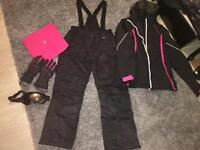 Women's ski wear size medium and other accessories are one size
