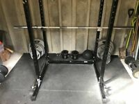 Complete barbell and dumbbell set up with power rack and bench