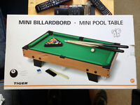Mini billiard table.
