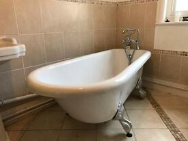 Bath with tap and feet