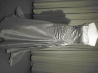 An elegant wedding gown by Natalie M, size 14, brand new, Clearance Sale