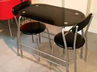 Spce saving Black glass table with 2 chairs
