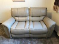 Two, 2 seater sofa's (Brand new) with one a full electric recliner