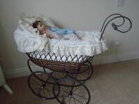 Childs wicker dolls pram.