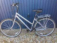 Ladies Apollo road bicycle with 21 gears and includes 2 panniers