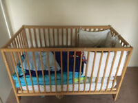 Baby cot with mattress and cot sheet