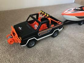 Playmobil truck with speed boat set and 2 figures